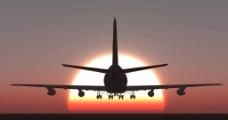 夕阳下的飞机图片