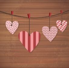 爱心吊饰木纹背景矢量素材