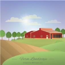阳光灿烂的一天里有一座谷仓的农场景观